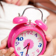 Beautiful woman sleeping and alarm clock - Stock Photo