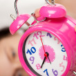 Beautiful woman and alarm clock — Stock Photo #9255981