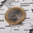 Stock Photo: Coins on map