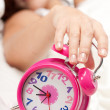 Beautiful woman  and alarm clock — Stock Photo