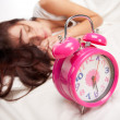 Royalty-Free Stock Photo: Beautiful woman  and alarm clock
