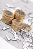 Coins on the map — Stock Photo
