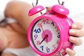 Beautiful woman and alarm clock — Stock Photo