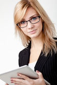 Businesswoman with electronic pad — Stock Photo
