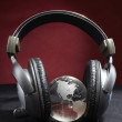 Glass globe and headphones — Stok fotoğraf