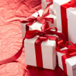 Beautiful gift boxes on the red background — Stock Photo #9640923