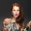 Beautiful woman with bottle of champagne — Stock Photo #9640976