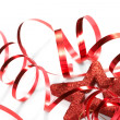 Red ribbon with star on the white background — Stock fotografie