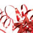 Red ribbon with star on the white background — Stok fotoğraf