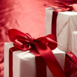 Beautiful gift boxes on the red background — Stock Photo #9641116
