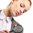Portrait of young businesswoman with magnifying glass — Stock Photo #9641434