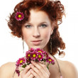Portrait of a happy women with flowers — Stock Photo #9641522