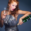Beautiful woman with champagne — Stock Photo