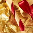 Satin ribbons on the gold background — Stock Photo