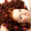 Portrait of a happy women with flowers in her hair — Stock Photo #9641899
