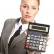 Portrait of young businesswoman with calculator — Stock Photo