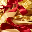 Royalty-Free Stock Photo: Satin ribbons on the gold background