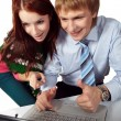 Young couple looking at laptop — Stock Photo
