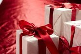 Beautiful gift boxes on the red background — Stock Photo