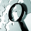 Magnifying glass, puzzle - Stockfoto