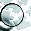 Magnifying glass, puzzle — Stock Photo #9831546