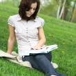 Girl with the book on the nature — Stock Photo