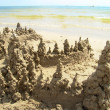 Towers sand on sea coast — Stock Photo