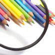 Stock Photo: Color pencils, magnifier
