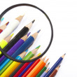Color pencils, magnifier - Stock Photo
