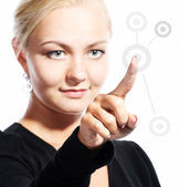 Young woman pushing a start button — Stock Photo