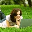 The girl with laptop on the nature — Stock Photo #9843468