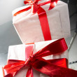 Gift with red tapes and bows — Stock Photo #9843660