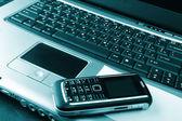 Notebook, telefon, obchodní technologie — Stock fotografie