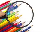 Color pencils, magnifier — Stock Photo