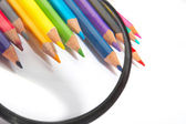 Color pencils, magnifier — Stock Photo