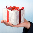 Royalty-Free Stock Photo: Man holiday and offering a gift on his hand