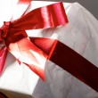 Gift with red tapes and bows — Stock Photo