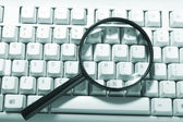 Magnifying glass, button, key — Stock Photo