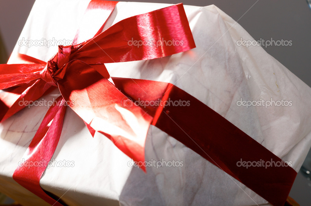 Gift with red tapes and bows — Stock Photo #9871471
