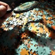 Magnifying glass, puzzle — Stockfoto #9892833