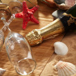 Champagne sparkling on a beach — Stock Photo #9914317