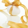 Easter egg with a bow golden — Stock Photo #9962452