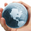 World in hand and global internet and business — Stock Photo #9968092