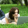 Stock Photo: The girl with laptop on the nature