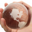 World in hand and global internet and business - Stock Photo
