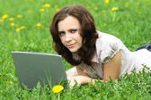 The girl with laptop on the nature — Stock Photo