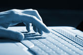 Male hands typing on a laptop — Stock Photo