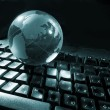 Globe and keyboard - Stock Photo