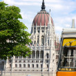 Tramway and parliament building in Budapest, Hungary - Stock Photo