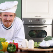 Young chef preparing lunch in kitchen — Stock Photo #9059597